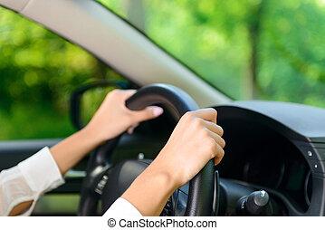 Close up of woman driving car - Driving forward. Close up...