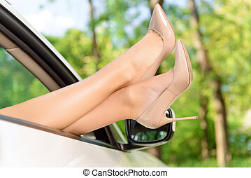 Woman legs looking out of car - Taking pleasure Close up...