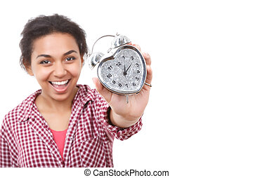 Smiling mulatto girl showing alarm clock - Showing off...