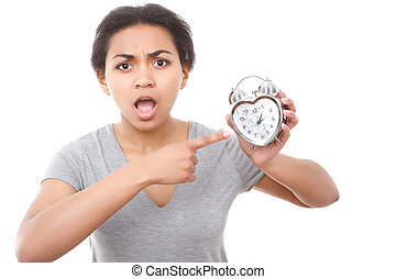 Young mulatto girl posing with alarm clock - High time...