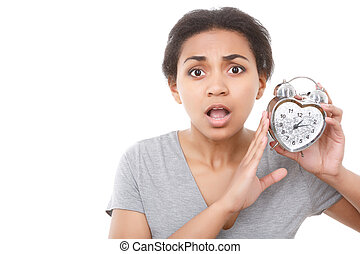 Young mulatto girl posing with alarm clock - Oh my god...