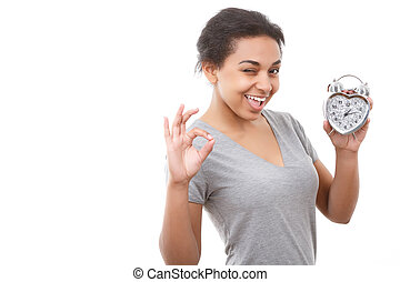 Young mulatto girl posing with alarm clock - It is ok Pretty...