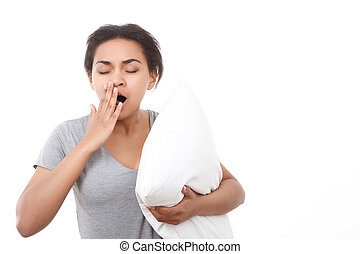 Pretty woman yawning on white isolated background.