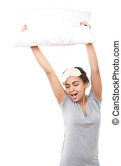 Smiling mulatto girl holding pillow up - Morning gymnastic...