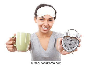 Smiling mulatto girl showing cup and alarm clock - Breakfast...
