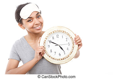 Pretty mulatto girl posing with clock - Time to go Beautiful...