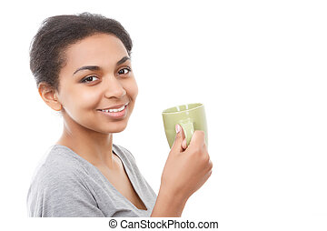 Beautiful young woman standing with cup - Smiling eyes...