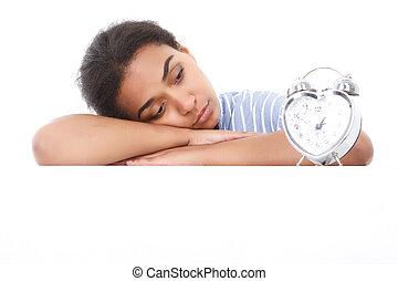 Mulatto girl leaning and looking at alarm clock - Killing...