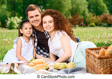 Happy family on a lunch in the park