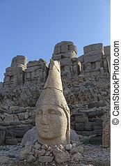 Stone head statues at Nemrut Mountain in Turkey - Nemrut is...