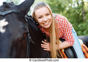 Young girl lying on the horse - My best friend Vivacious...