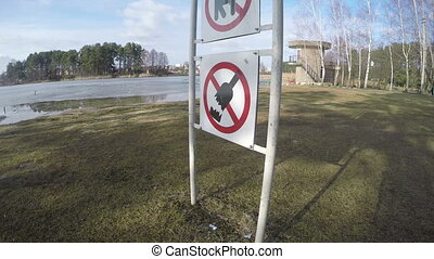 prohibiting signs - Prohibiting warning signs near lake No...
