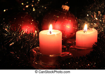 Candle Cristmas - Christmas candles against a tinsel and red...