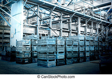Big storage room with metal boxes in factory