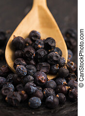 Juniper berries on a wooden background