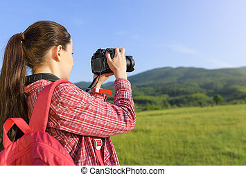 Female tourist photographing on camera - Female tourist...