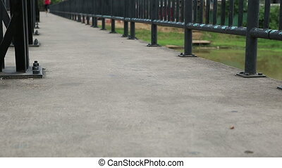 Runner athlete running on iron bridge woman fitness jogging...