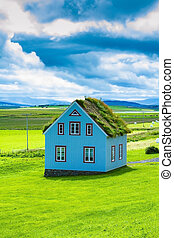The charming rustic rural house on green lawn. Travel to...