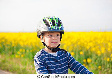 Little boy in a helmet - Portrait of a little boy in a...