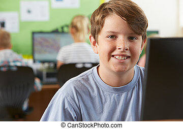 Male Elementary School Pupil In Computer Class