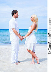 Loving couple walking and embracing on a tropical summer...