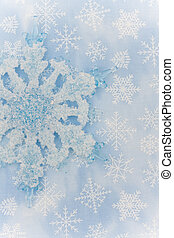 Snowflake - A close up of a snowflake on a blue snowflake...