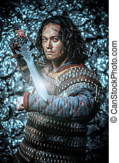 old history - Ancient male warrior in armor holding sword....