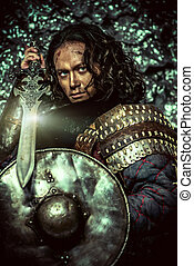 shield and sword - Ancient male warrior in armor holding...