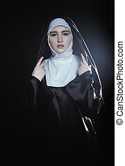 Catholic nun - Front portrait of the young beautiful nun....