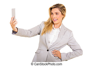young woman taking a selfie - beautiful young woman taking a...