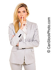 businesswoman saying shhh - beautiful businesswoman saying...