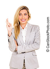businesswoman with fingers crossed - happy businesswoman...