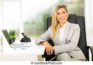 businesswoman sitting in office - relaxed businesswoman...