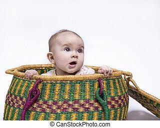 peek-a-boo - cute baby hiding in a basket