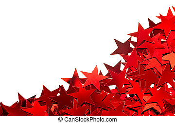 Holiday background - Red star shaped confetti on white...