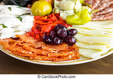 Antipasto - Appetizers plate with antipasto in Italian...