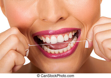dental hygiene woman cleaning teeth with floss