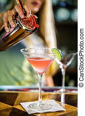 Cosmopolitan - Bartender preparing Cosmopolitan drink for...