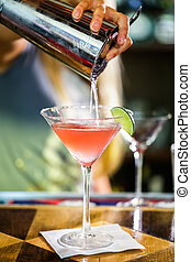 Cosmopolitan - Bartender preparing Cosmopolitan drink for...