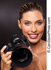 young woman holding a camera - beautifu