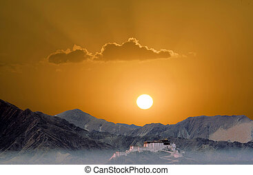 potala in Lhasa in sunset with mountains