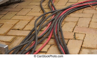 Electrical Power Cables on Ground - Heavy gauge electrical...