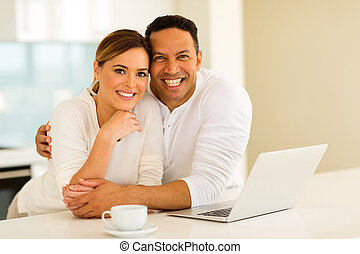 couple with laptop computer - lovely couple with laptop...