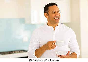 middle aged man drinking coffee - cheerful middle aged man...
