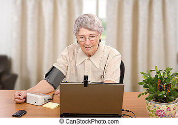 Blood pressure for online doctor - Old grey haired woman...