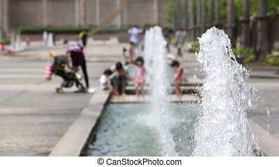water fountain with children in the park