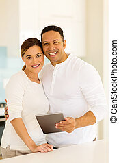 couple standing in kitchen - lovely couple standing in...