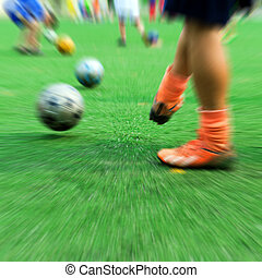 Children playing soccer - Close-up of little boy playing...