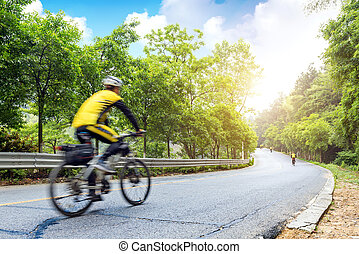 Cycling race - Cyclist riding a bike on an open road.