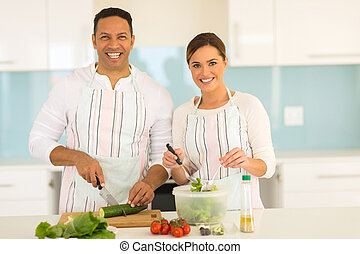 couple cooking in modern kitchen - portrait of happy couple...
